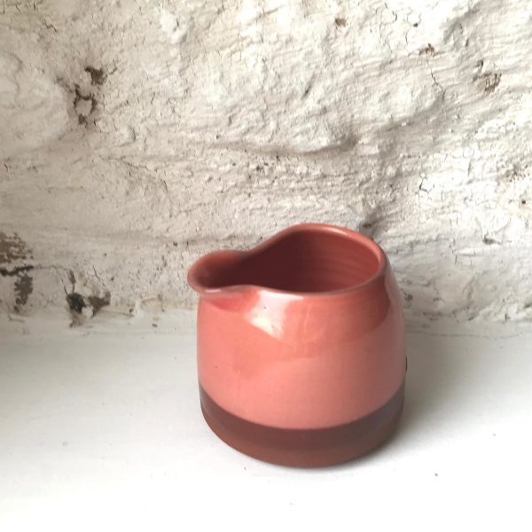Hand thrown pourer